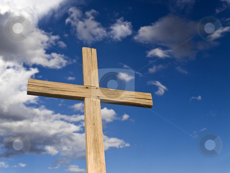 Wooden cross stock photo, A wooden cross over a blue sky with clouds. by Ignacio Gonzalez Prado