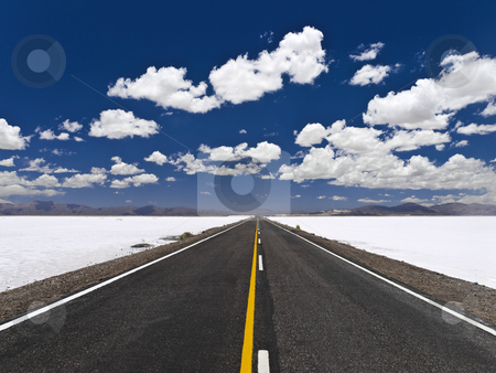 Infinite road stock photo, A straight road across an open salt mine. by Ignacio Gonzalez Prado