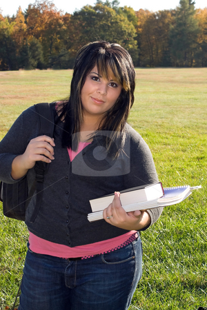 Going Back to School stock photo, A young woman walking on campus on a nice day with her books and backpack. by Todd Arena
