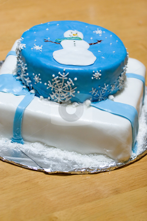 Snowman Cake stock photo, A cake with fondant icing featuring a winter design. by Todd Arena