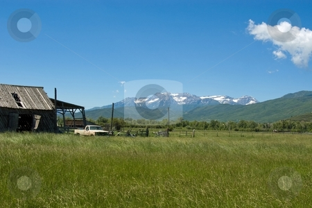 Mountain Valley stock photo, Ramshackle barns and an old truck at a farm in a mountain valley. by Andrew Orlemann