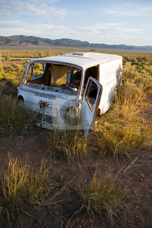 Parked stock photo, Abandoned camper van in a rural meadow. by Andrew Orlemann