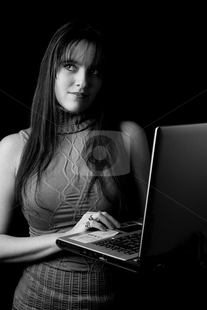Fashion model - Working on laptop stock photo, Twenty something fashion working on laptop standing by Yann Poirier
