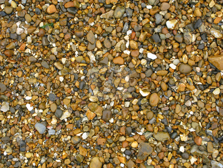 Colorful wet beach stones close up. stock photo, Colorful wet beach stones close up. by Stephen Rees