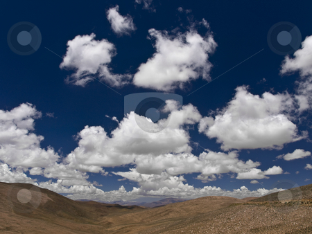 Cotton sky stock photo, Summer landscape with white clouds and a blue sky. by Ignacio Gonzalez Prado