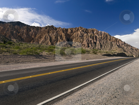 Sky, mountain and road stock photo, A stright road across the northwest desert. Argentina. by Ignacio Gonzalez Prado