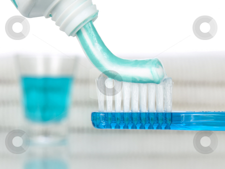 Blue morning stock photo, A blue toothbrush with toothpaste. Mouthwash and towels on the background by Ignacio Gonzalez Prado