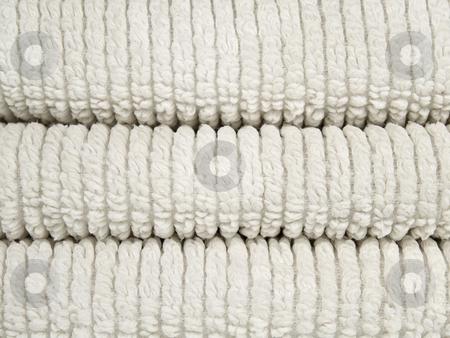 White towels stock photo, Three folded cotton towels. by Ignacio Gonzalez Prado