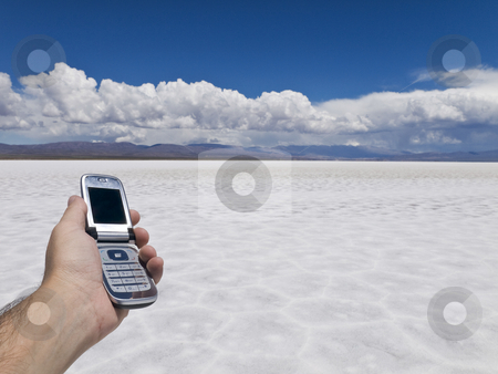 Lost in salt stock photo, A man holding a cell phone in an open salt mine. by Ignacio Gonzalez Prado
