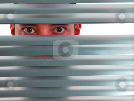 Red peeping Tom stock photo, A red man looks to the camera through the blinds. by Ignacio Gonzalez Prado