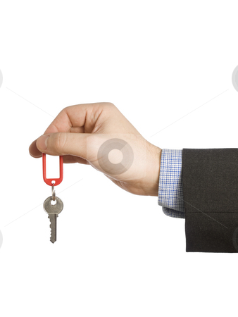 Starting business stock photo, A hand holding a red keyring with a blank label and a key. by Ignacio Gonzalez Prado