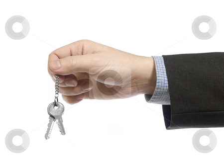 Brand new home stock photo, A business man holding a set of keys. by Ignacio Gonzalez Prado