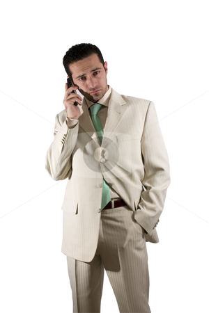 Businessman on the PDA phone stock photo, Businessman on the phone with one hand in pocket by Mehmet Dilsiz