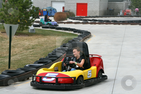 Teenager on the Go Cart stock photo, Teenager and her Mother racing on the Go Cart by Mehmet Dilsiz