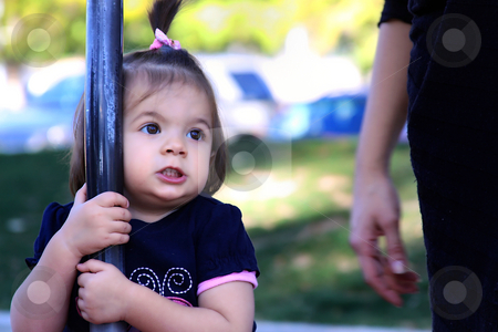 Little girl Playing at the Park stock photo, Littler Girl Playing At the Park, Looking at her Mother by Mehmet Dilsiz