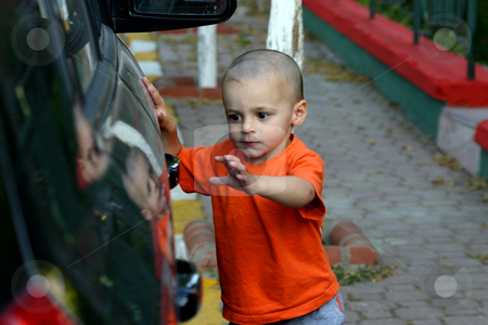 I'm getting the Door stock photo, Little Boy Unlocking the Car Door by Mehmet Dilsiz