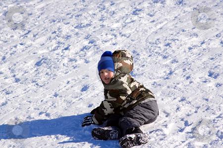 Little Boy Sledding down the Hill stock photo, Little Boy Sledding down the Hill - Winter Scenes by Mehmet Dilsiz