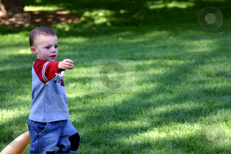 Give me the Ball stock photo, Little Boy playing baseball - asking for the ball by Mehmet Dilsiz