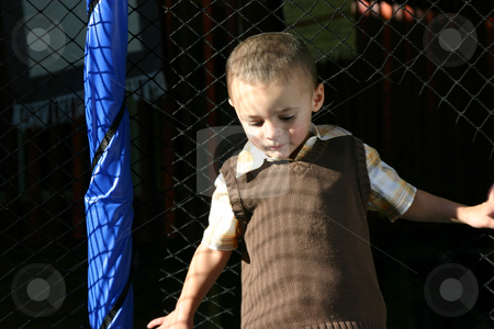 Little Boy Looking Down stock photo, Isolated Little Boy Looking Down by Mehmet Dilsiz