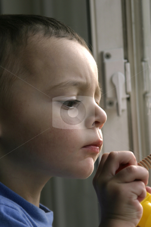Close Up on Child and His Undivided Attention stock photo, Close up on a Child concentrating on his task in hand by Mehmet Dilsiz