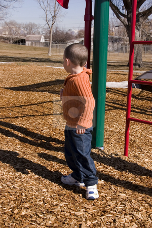 Where is Everyone stock photo, Little Boy Looking for Everyone in the Playground by Mehmet Dilsiz