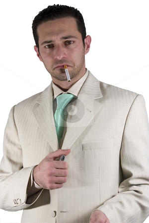 Businessman lighting up a cigarette stock photo, Isolated Businessman lighting up a cigarette by Mehmet Dilsiz