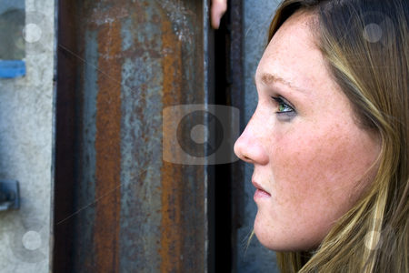 Close up on a Girl with Grunge Background stock photo, Close up on a Girl with Rust Mettalic Grunge Background by Mehmet Dilsiz
