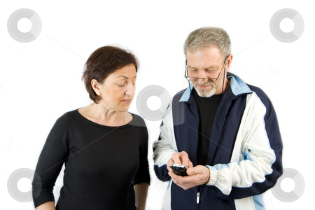 Couple checking the text message stock photo, Husband on the Phone checking an incoming text message while wife looking over his shoulder- Isolated by Mehmet Dilsiz