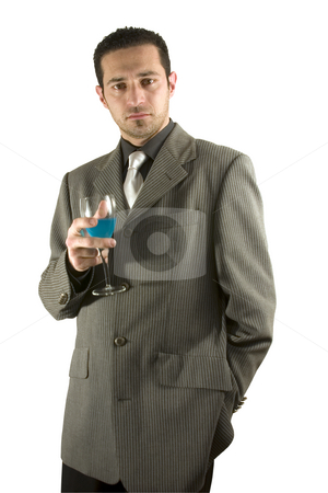Businessman celebrating with a glass of drink stock photo, Isolated businessman celebrating with a glass of drink by Mehmet Dilsiz