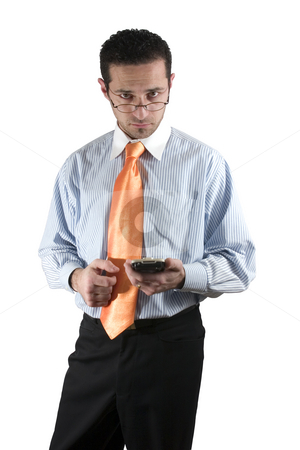 Businessman looking over his glasses with PDA on hand stock photo, Isolated businessman looking over his glasses with a PDA on hand by Mehmet Dilsiz