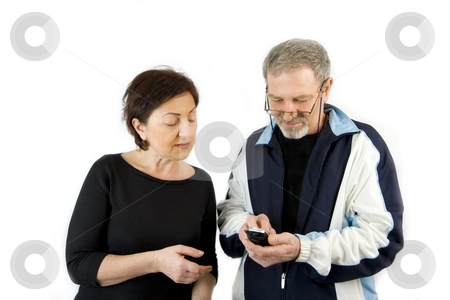 Couple checking the Text Message on the Phone stock photo, Couple checking the Text Message on a Wireless Phone by Mehmet Dilsiz