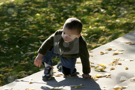 Kid Climbing Up stock photo, Kid Climbing up the Rock Benches by Mehmet Dilsiz