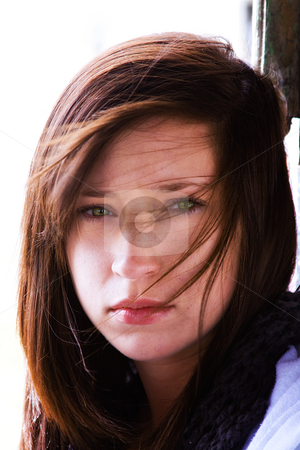Beautiful Teenager stock photo, Close up on a Beautiful Teenager with Wind Blowing Her Hair by Mehmet Dilsiz