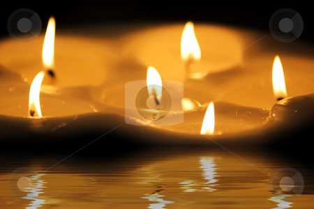 Candles stock photo, Some beautiful candles standing on the floor by Dmitry Rostovtsev