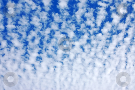 Clouds in the sky stock photo, Clouds in the blue sky by Dmitry Rostovtsev