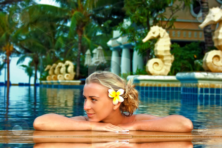 Spa in the pool stock photo, Young lady enjoying spa procedures in the open air pool by Dmitry Rostovtsev