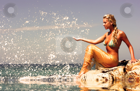 Mermaid at beach stock photo, Blonde mermaid sitting on the rocky beach by Dmitry Rostovtsev