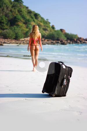 Luggage on the beach stock photo, Suitcase standing on the sand beach by Dmitry Rostovtsev