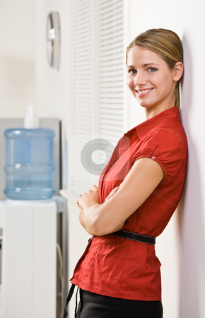 Businesswoman leaning against wall stock photo, Businesswoman leaning against wall by Jonathan Ross