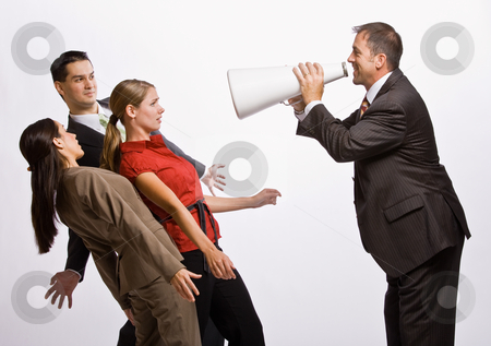 Businessman shouting at co-workers with megaphone stock photo, Businessman shouting at co-workers with megaphone by Jonathan Ross