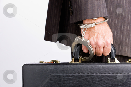 Businessman handcuffed to briefcase stock photo, Businessman handcuffed to briefcase by Jonathan Ross