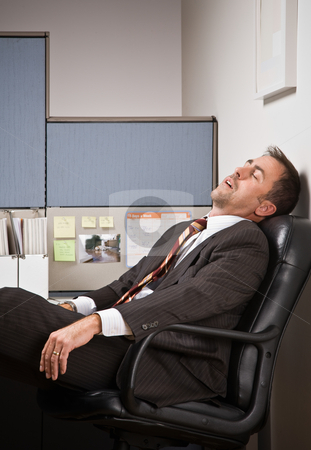 Businessman sleeping at desk stock photo, Businessman sleeping at desk by Jonathan Ross