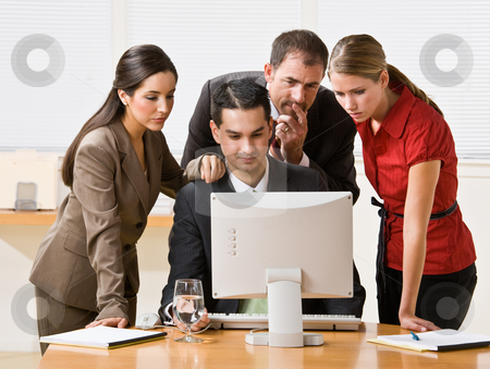 Business people looking at computer stock photo, Business people looking at computer by Jonathan Ross