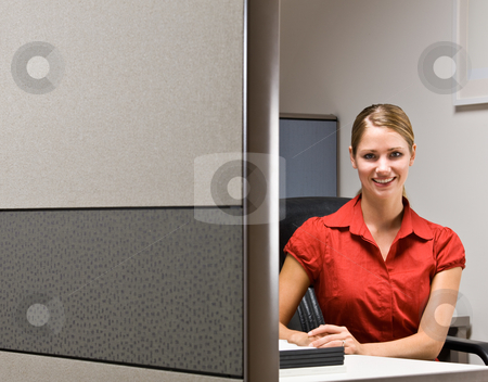 Businesswoman sitting at desk smiling stock photo, Businesswoman sitting at desk smiling by Jonathan Ross
