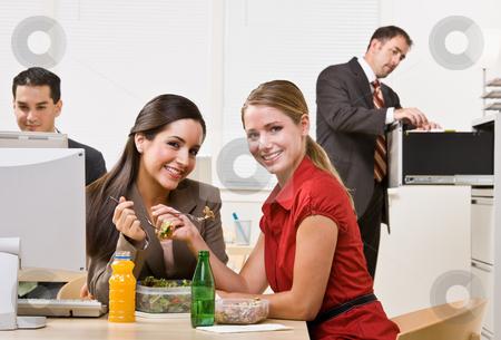 Businesswomen eating salad for lunch stock photo, Businesswomen eating salad for lunch by Jonathan Ross