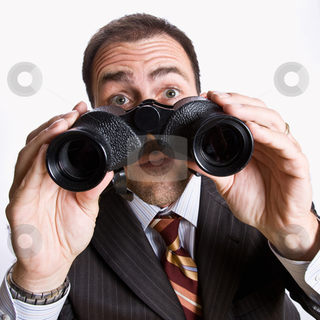 Businessman looking through binoculars stock photo, Businessman looking through binoculars by Jonathan Ross