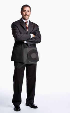 Businessman smiling with arms crossed stock photo, Businessman smiling with arms crossed by Jonathan Ross