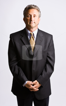 Businessman with hands clasped stock photo, Businessman with hands clasped by Jonathan Ross