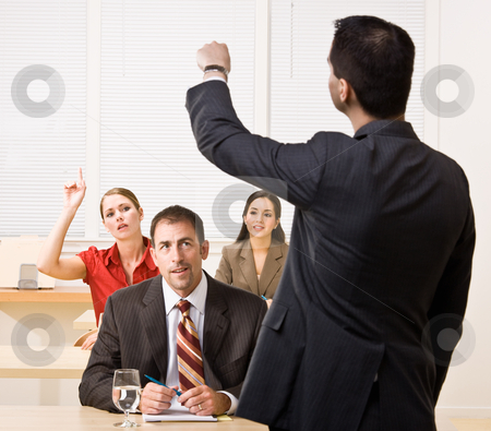 Businessman answering questions in meeting stock photo, Businessman answering questions in meeting by Jonathan Ross