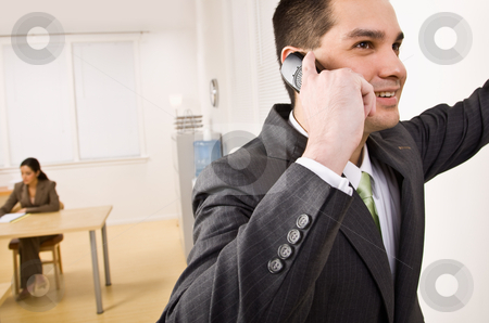 Businessman talking on cell phone stock photo, Businessman talking on cell phone by Jonathan Ross